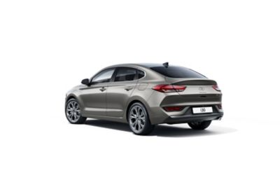 The new Hyundai i30 Fastback pictured from the driver side rear.