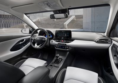 Front interior of the new Hyundai i30 as seen from the back seat.