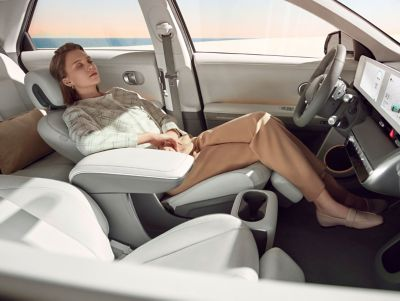 The fully reclining front seats of the Hyundai IONIQ 5 electric midsize CUV.