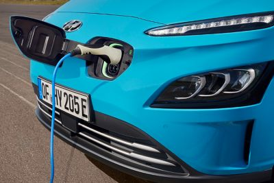 The new Hyundai Kona Electric compact SUV getting charged.