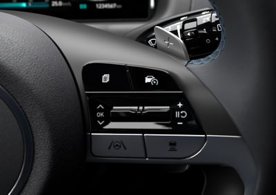 The paddle shifters on the steering wheel of the all-new Hyundai Tucson Hybrid compact SUV.